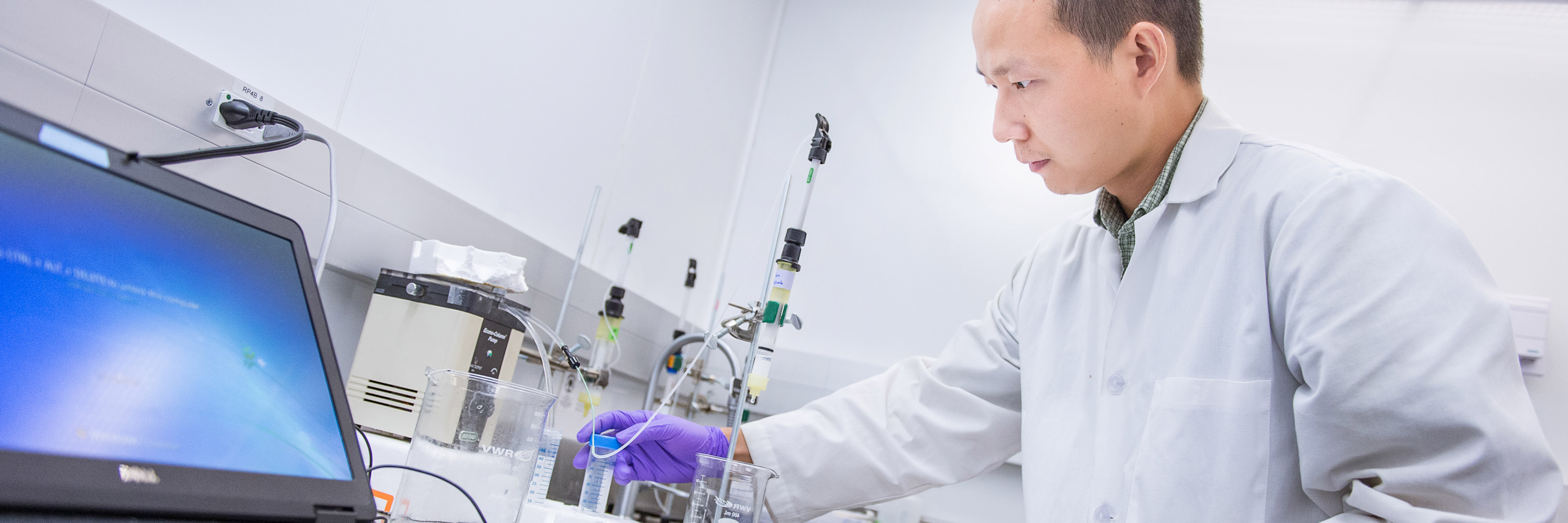 Man working with lab equipment